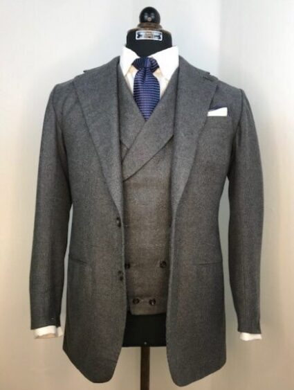 Jacket and double breasted waistcoat with peaked lapels in grey 13 oz flannel from Harrisons,.